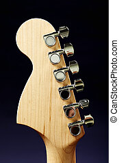 Guitar headstock back against dark background