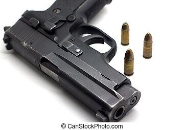 Gun with ammunition on white background