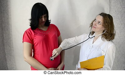 doctor uses a stethoscope for young