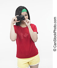 woman talking picture - asian woman with a hot shot camera...