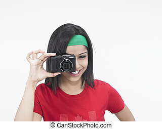 woman with a hot shot camera - asian woman with a hot shot...