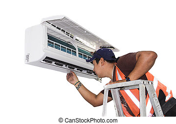 Air Conditioning Repair - Young repairman fixing a ductless...