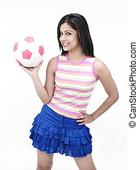 asian femalw with a football - asian girl of indian origin...