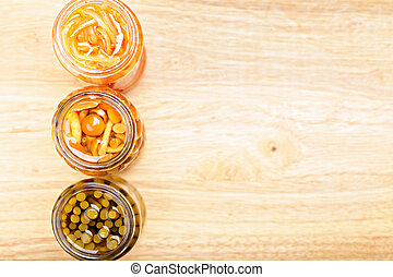 Canned vegetables above view - Various canned vegetables on...