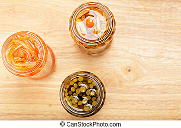 Canned food above view - Various canned food on wooden board...