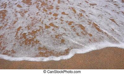 Wave Foam on a Sandy Beach