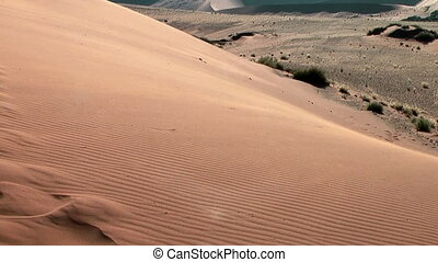 sand floating over big daddy dune at soussuvlei in namibian...