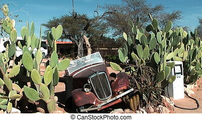 Old car wreck in namibia desert at solitaire