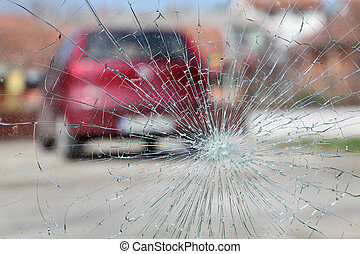 Broken glass - Broken windshield with red car in background