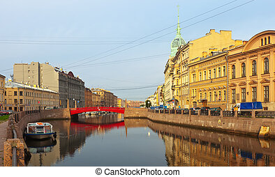 Red Bridge through Moyka River - ST.PETERSBURG, RUSSIA -...