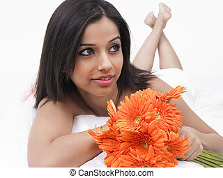 woman with a bunch of gerberas