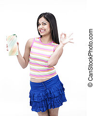 girl holding package of juice - asian girl of indian origin...