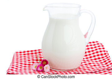 glass pitcher full of milk