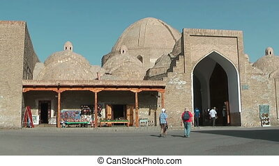 Trade dome Tagi Zargaron Bukhara - Tourists walking to Trade...