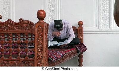 uzbekistan muslim sitting on divan - Uzbekistan muslim...