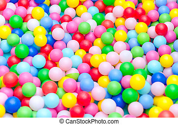 A lot of coloured plastic balls in playroom