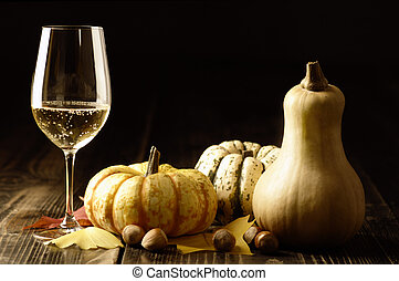 Pumpkins and autumn leaves with white wine - Autumn theme;...