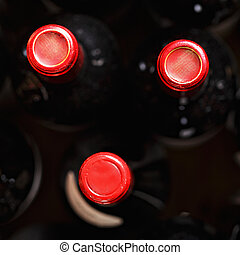 Wine bottles above view - Wine bottles with red caps above...