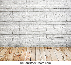 Room interior with white brick wall and wood floor...