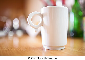 Cup of coffee or tea on wooden table, small dof