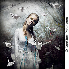 Imagination. Romantic Blonde with Hovering Origami Birds in...