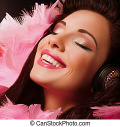 Inspiration. Fancy Cheerful and Happy Woman with pink Feathers smiling. Pleasure
