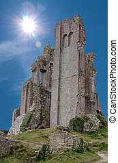 Corfe Castle ruins against blue sky