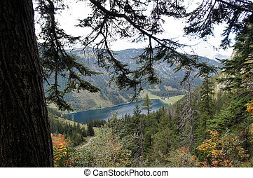 The Vilsalpsee in the Tannheim Valley in autumn, surrounded...