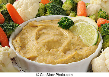 Hummus with vegetables - A bowl of hummus with carrots,...