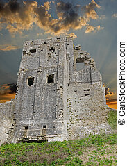 Corfe Castle ruins against stormy sky