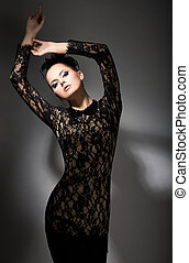 Gracefulness. Enticing Classy Woman in Black dress in...
