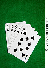 Royal Flush - A royal flush in spades on a green felt...