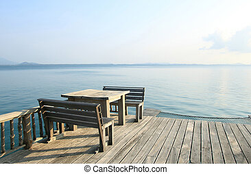 wooden table and chairs on a tropical beach resort
