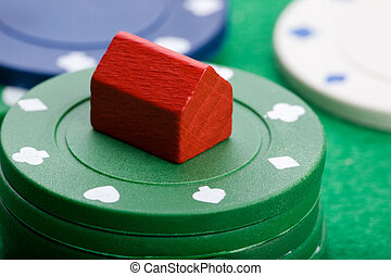 Housing Market Gabmle - Casino chips with toy house -...