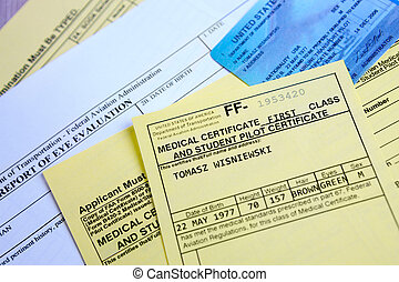 Aeromedical Exam - Close up of an airplane pilot's papers...