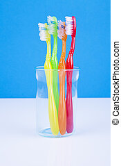 toothbrushes in water glass