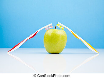 grean apple and toothbrushes