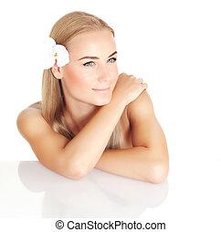 Beautiful female in spa salon