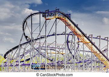 Roller coaster in city amusement park