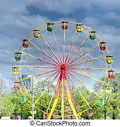 Ferris wheel in city amusement park