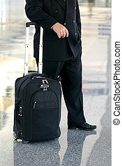 business man standing in the airport - An image of a...