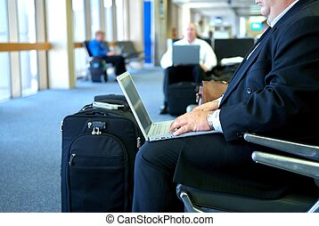 business man on his laptop in the airport - An image of a...