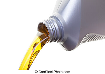 Oil Change - Pouring oil from a jug, shot on a whit...