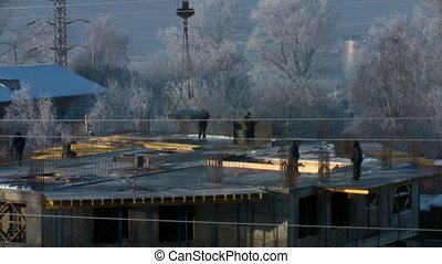 Workers at a construction site in the frost