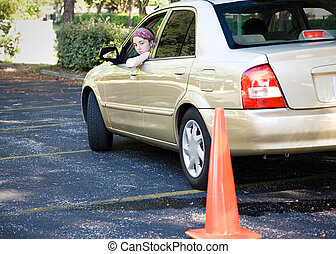 Teen Driving Test - Parking - Teen driver backs up, doing...