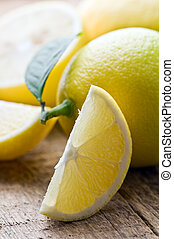 lemons on wood table closeup