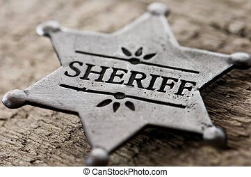 sheriff star isolated on black