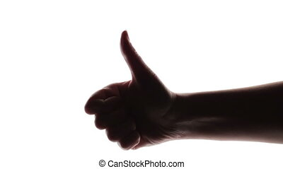 Silhouette of woman's hand giving thumb up on white...