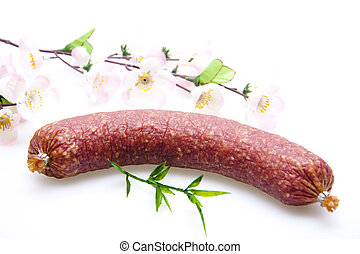 Garlic sausage with flowering branch