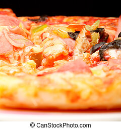 Plate with prepared pizza selective focus
